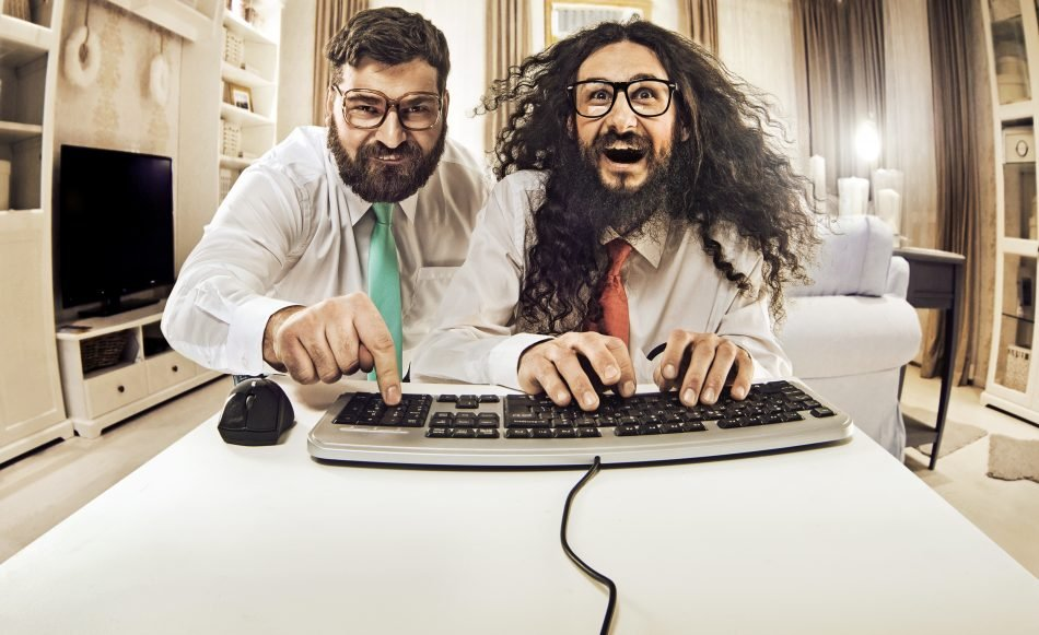Two men having fun on computer