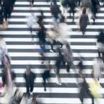 Crowd of people crossing a street